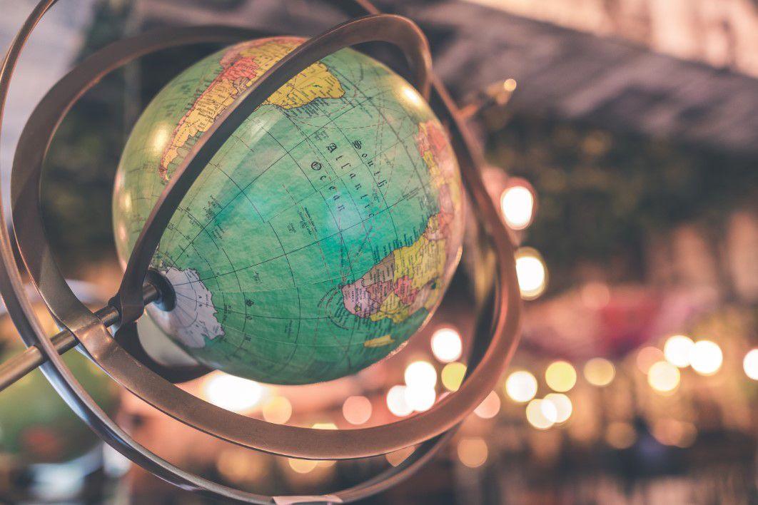 negative-space-vintage-globe-world-map-bokeh-artem-bali-thumb-1