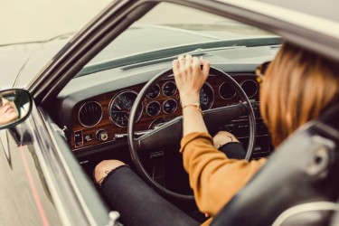 negative-space-thumb-woman-driving-vintage-car